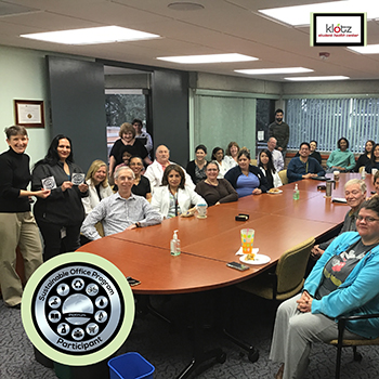 Photo of people sitting in the round table in the Klotz Center, One of the offices that is an SOP Super star